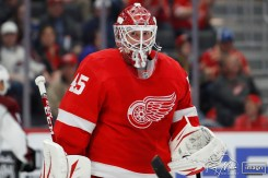 Mar 2, 2020; Detroit, Michigan, USA; Detroit Red Wings goaltender Jonathan Bernier (45) holds onto the puck during the first period against the Colorado Avalanche at Little Caesars Arena. Mandatory Credit: Raj Mehta-USA TODAY Sports