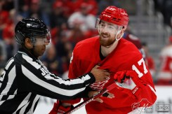 Mar 2, 2020; Detroit, Michigan, USA; Detroit Red Wings defenseman Filip Hronek (17) gets held back by a referee during the first period against the Colorado Avalanche at Little Caesars Arena. Mandatory Credit: Raj Mehta-USA TODAY Sports