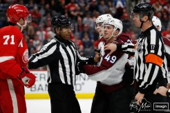 Mar 2, 2020; Detroit, Michigan, USA; Colorado Avalanche defenseman Samuel Girard (49) and Detroit Red Wings center Dylan Larkin (71) exchange word during the second period at Little Caesars Arena. Mandatory Credit: Raj Mehta-USA TODAY Sports