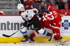 Mar 2, 2020; Detroit, Michigan, USA; Colorado Avalanche center Nathan MacKinnon (29) wins the puck against Detroit Red Wings defenseman Patrik Nemeth (22) during the third period at Little Caesars Arena. Mandatory Credit: Raj Mehta-USA TODAY Sports