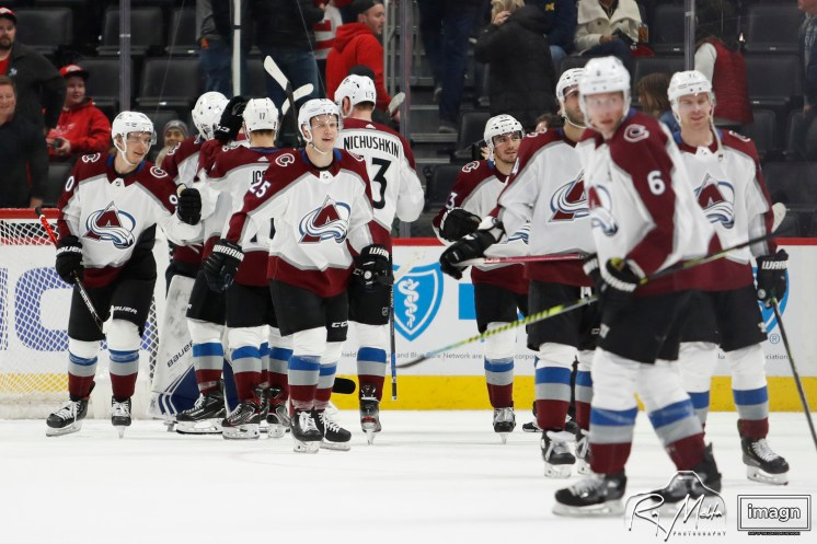 Mar 2, 2020; Detroit, Michigan, USA; Colorado Avalanche right wing Logan O'Connor (25) celebrates with teammates after the game against the Detroit Red Wings at Little Caesars Arena. Mandatory Credit: Raj Mehta-USA TODAY Sports