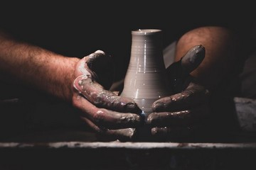 Potter throwing at the pottery wheel