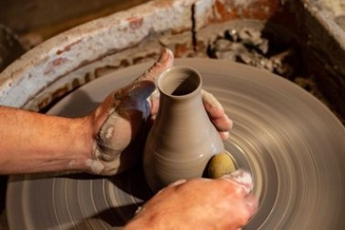 Potter throwing on the wheel.