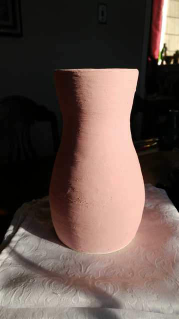 glazed, unfired raku pottery vase red