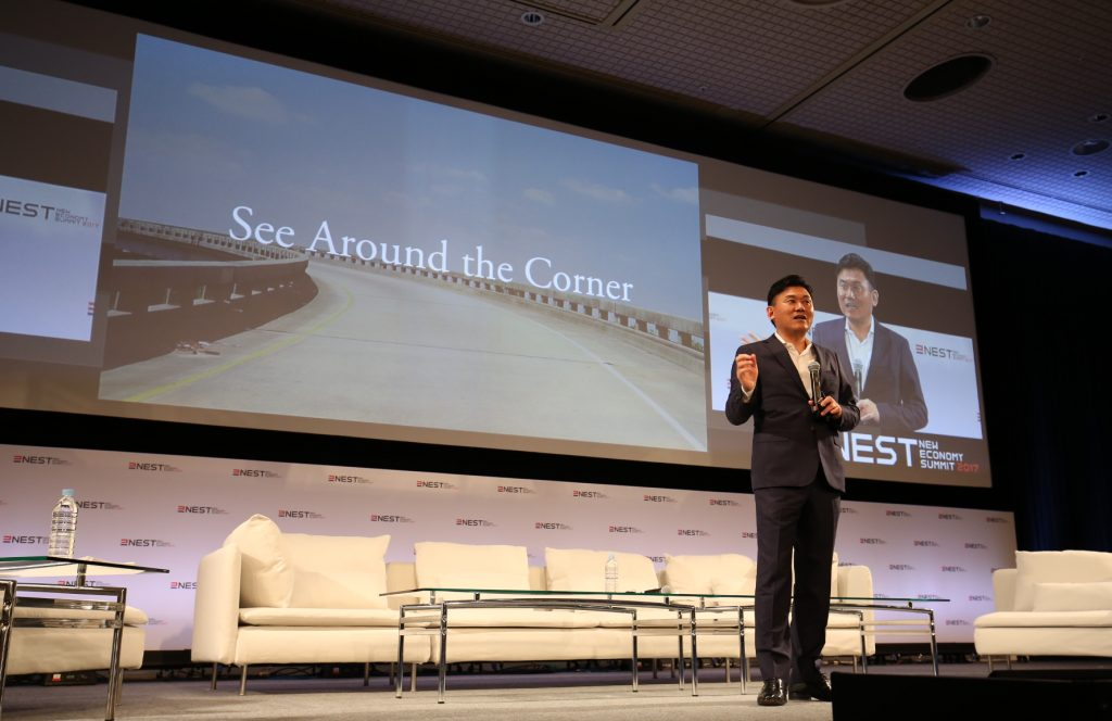 "Mickey Mikitani, Representative Director of JANE and Chairman and CEO of Rakuten, kicked off NEST 2017 by encouraging participants to ""see around the corner."""