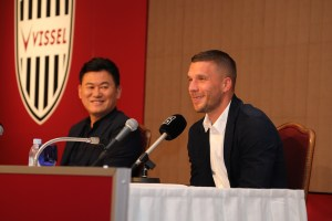 "Rakuten CEO Hiroshi ""Mickey"" Mikitani and Lukas Podolski talk to journalists."