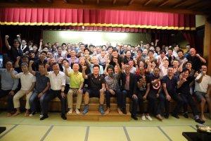Rakuten executives celebrate after the Mt Tanigawa climb.