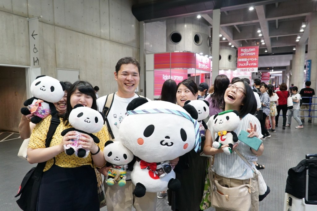 A group of Future World visitors show off their panda spirit in Yokohama.