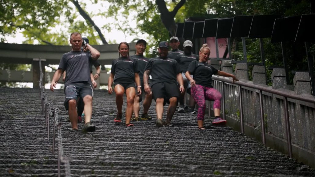"""Led by Spartan CEO Joe De Sena, the group had to scale a flight of stairs known as the """"stone steps to success"""" while carrying a 40lb (18kg) kettlebell weight up and down."""