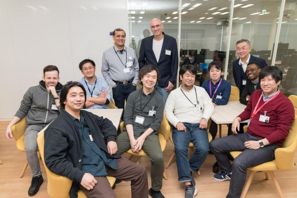 Sagiv (standing, center) with members of Rakuten Mobile's Service Experience Center.