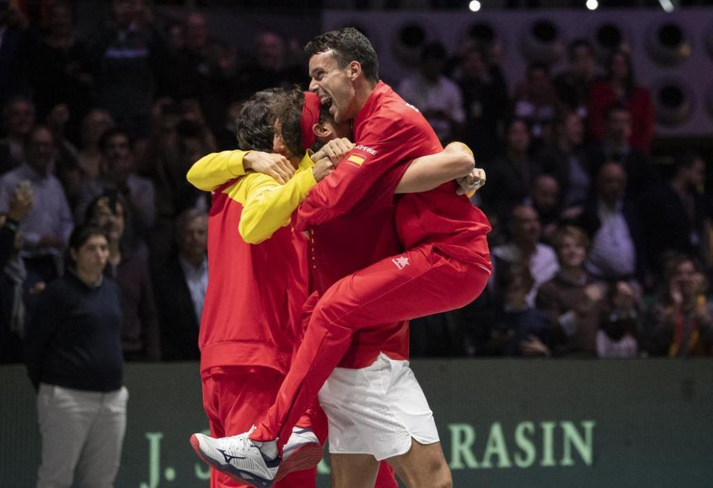 Spain's Rafael Nadal and Roberto Bautista embrace moments after winning the 2019 Davis Cup.