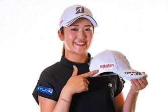 Mone Inami poses with a Rakuten logo-emblazoned golf cap.