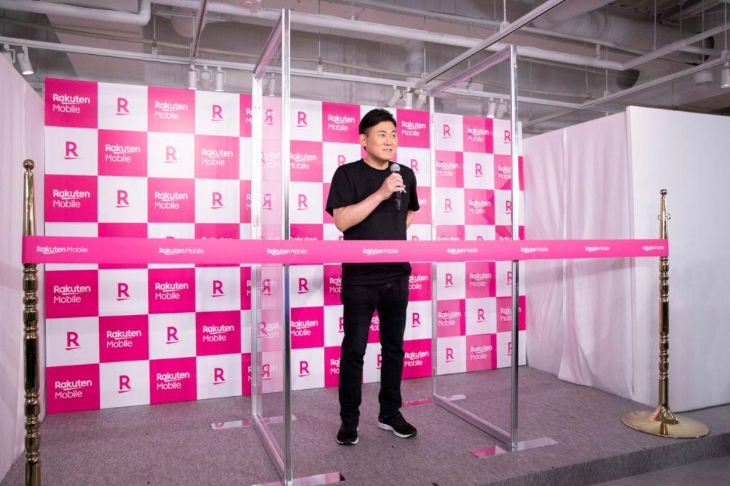 Rakuten Mobile Chairman and CEO Mickey Mikitani speaking at the iPhone launch event at the new Rakuten Mobile Roppongi Store.