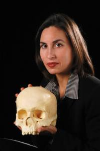 CHASS researcher Ann Ross and a human skull. PHOTO BY ROGER WINSTEAD