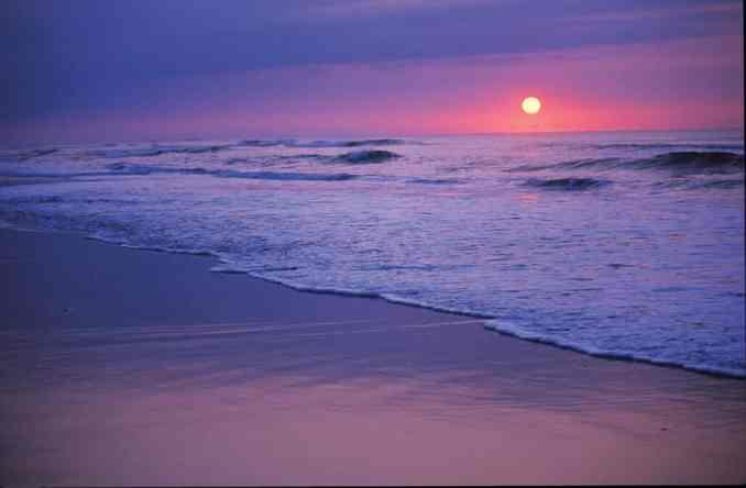 The sun rises over the Atlantic Ocean on the North Carolina coast.