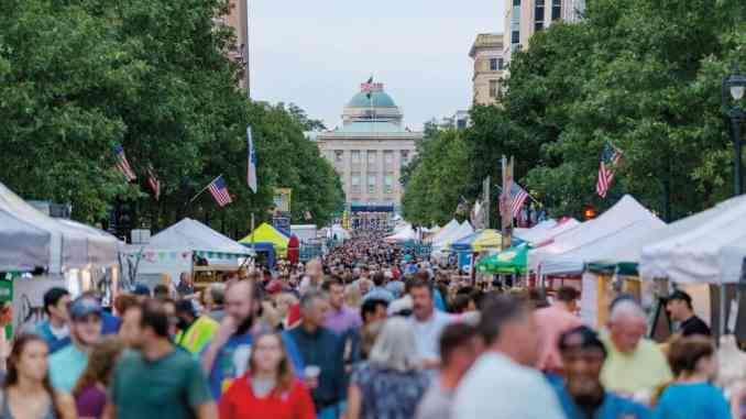 People pack the streets of Raleigh during the IBMA World of Bluegrass event.