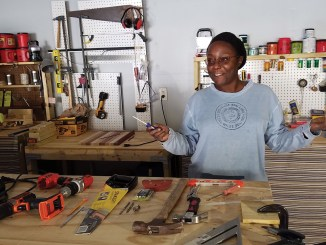 Tonya Gosby in her home woodworking studio