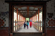 I got to take this picture by pure chance. One minute the bridge was empty. The other minute they were there. A monk, and mother and child, crossing a traditional cantilever bridge. Bhutan's ancient bridges are made up of immense, interlocking wooden structures, and have carried human and animal traffic for centuries.