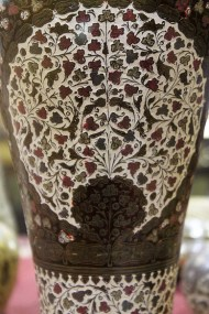 Jar, Lacquer on brass: This art style has its origin as brass imitations of Bidri artefacts. It earlier had bold designs in relief, but adopted intricate patterns to cater to Europe's penchant for detailed ornamentation. Craftsmen in Jaipur later introduced a rich variety of colours in lacquer to apply on the brass ware, leading to its current known form.