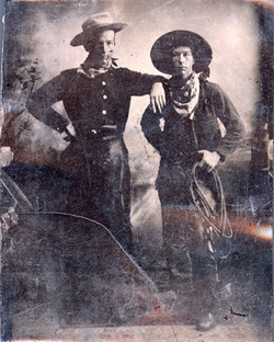 studio portrait of two cowboys