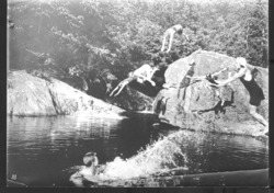 photograph of Biltmore Forestry School students diving into a swimming pool near Sunburst, N.C.
