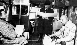 photograph of CR reading in a Brooklyn bus