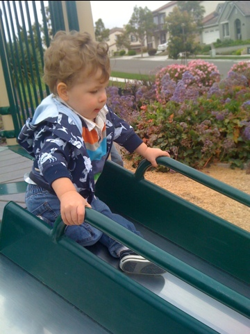 Frustrated toddler trying to slide