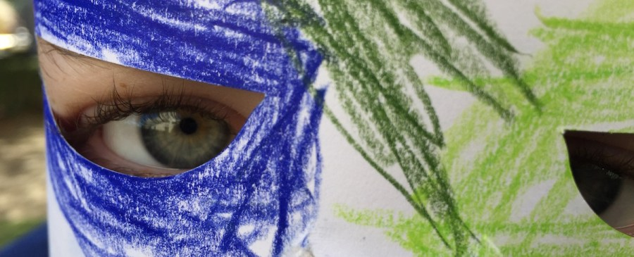 Closeup of Kid Wearing Paper Mask