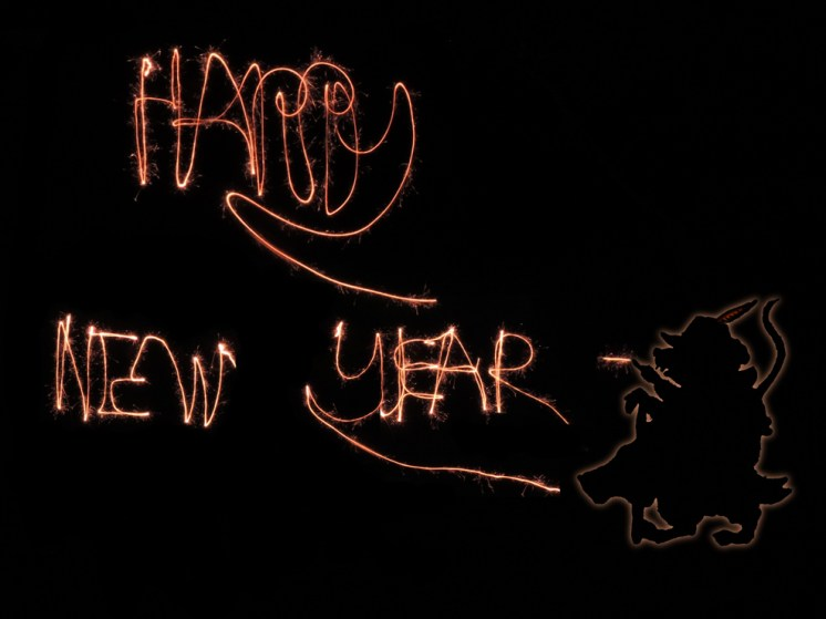 Photo of happy new year written in sparklers