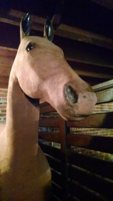 Stuffed or fake horse in the stable