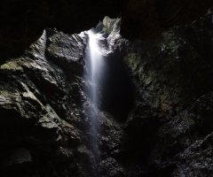 A bright light in a dark cave