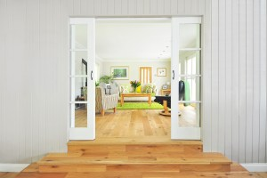view of living room through sliding french doors with beautiful hardwood flooring