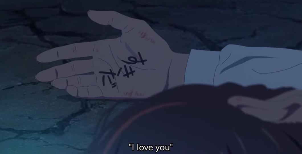What did taki write on mitsuha's hand