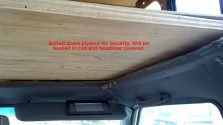 We replaced the previously removable section of the bed with bolted-down plywood to allow us to create a security divider between cab and camper.