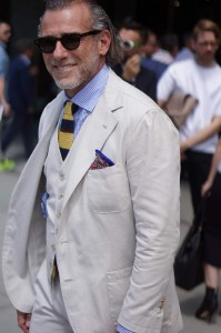 Three-piece-summer-suit-with-spalla-camicia-and-knit-tie-that-pokes-out-of-underneath-the-vest