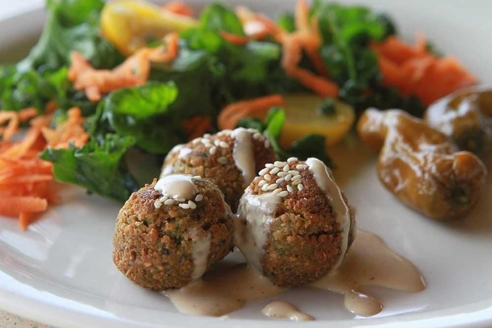 3 falafel balls with drizzled tahini