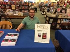 Writer Randal Eldon Greene signing his novel at Barnes & Noble in Sioux City