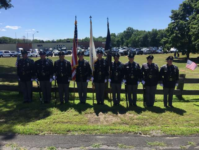 Pictured from left to right: Cmdr. John Hamelburg, Officer Kevin Gilbert, Det. Sgt. Jason Fisher, Lt. Anthony Marag, Det. Richard Brewer, Officer Billy Lok, Officer Matthew Rodman, Det. Sgt. Christine Morse, Cmdr. David Avery