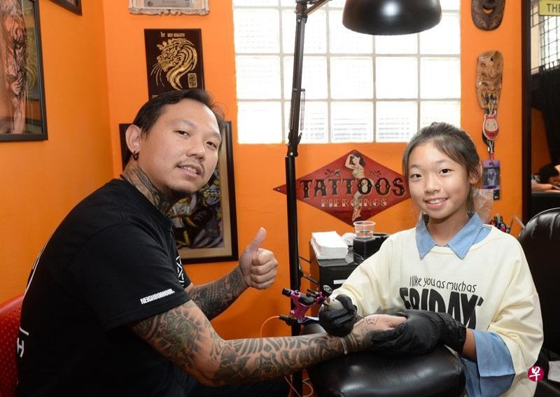 Would you let yourself be tattooed by this 13-year-old girl?