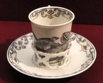 Chocolate_cup_with_trembleuse_saucer,_c._1735-1740,_Du_Paquier_factory,_hard-paste_porcelain,_Schwarzlot_overglaze_black_enamel,_gilding_-_Gardiner_Museum,_Toronto_-_DSC01014