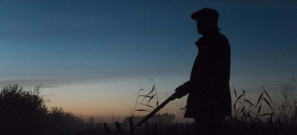 hunter silhuetted against the dusky sky