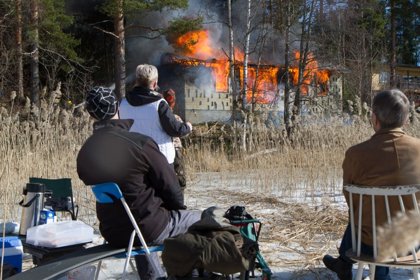 civilians watching a burning building