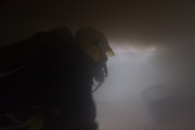 firefighter venting a smoky room