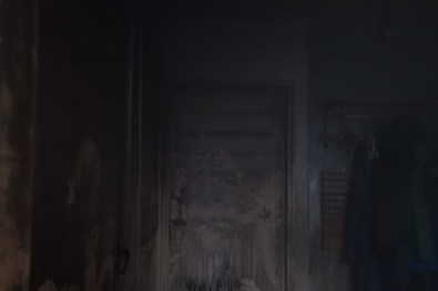 Door covered in soot from the fire