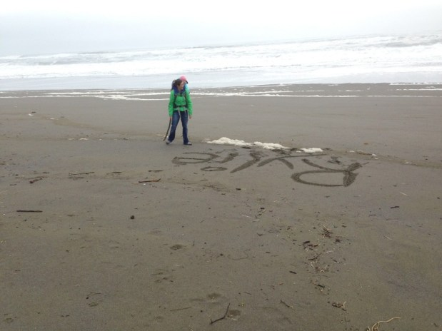 Playing in the sand at Gold Beach Oregon