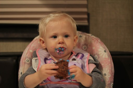 Eating her first self decorated cup cake