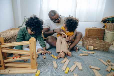 A dad playing with his kids at Randomnestfamily.org