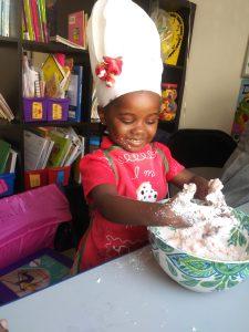 Randomnestfamily.org toddler working in messy dough.