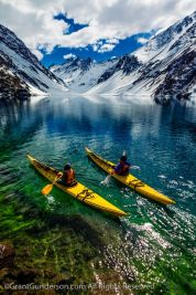 James Heim and Michelle Parker using Kayaks to access skiing on Laguna de Incas in Portillo Chile