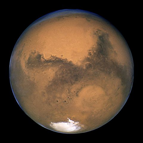 Mars-the-red-planet-appears-pinkish-red-covered-with-grayish-swaths-as-seen-by-Hubble-Telescope